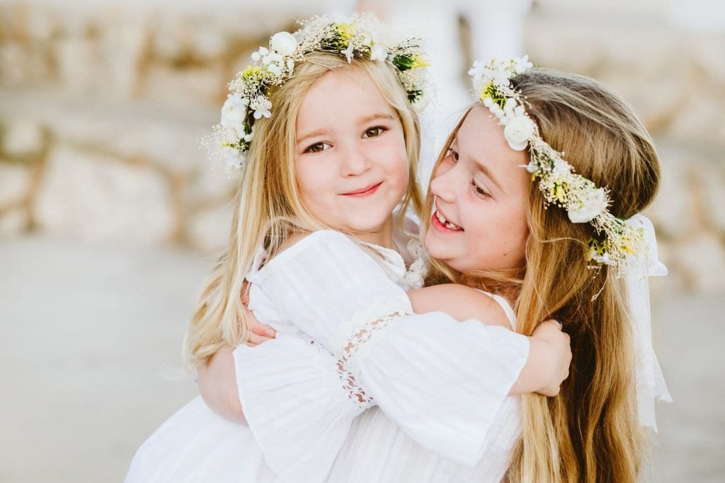 Sisters giving a hug during a photoshoot in Mallorca