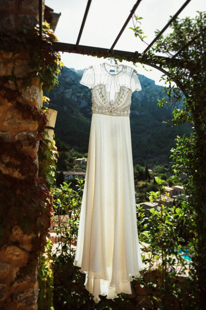 Wedding dress hanging outside of hotel room