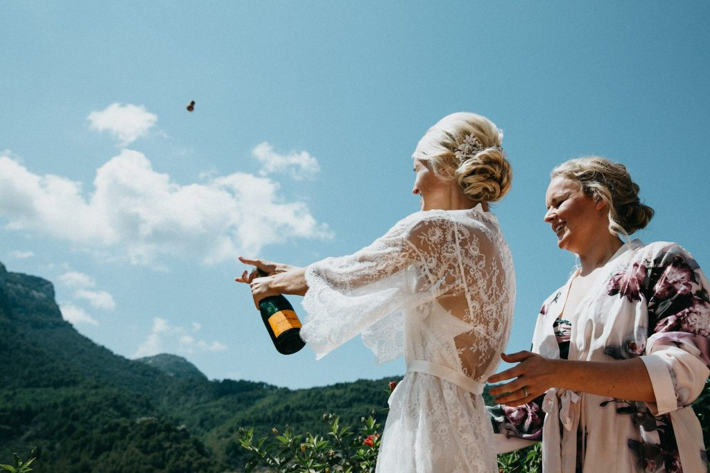 Popping a bottle of champagne with maid of honour