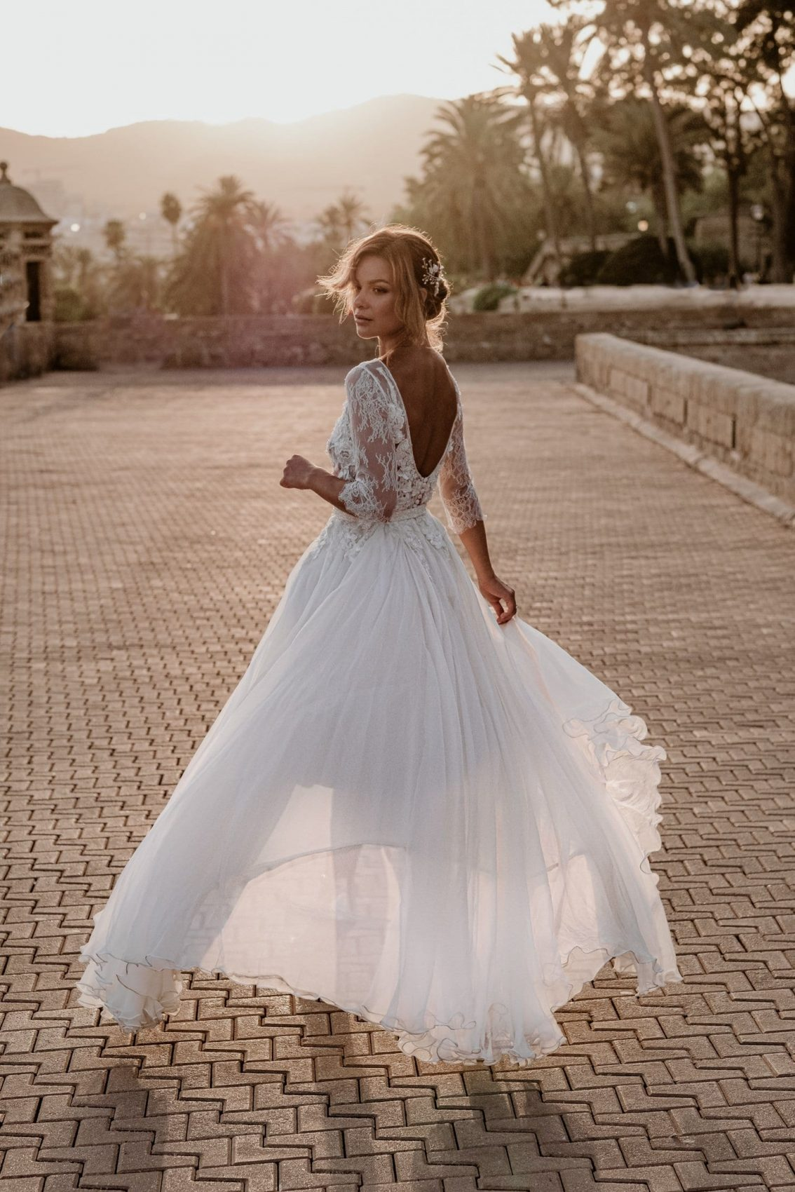 Bride wears a stunning bridal gown by Predrag Djuknik in Mallorca