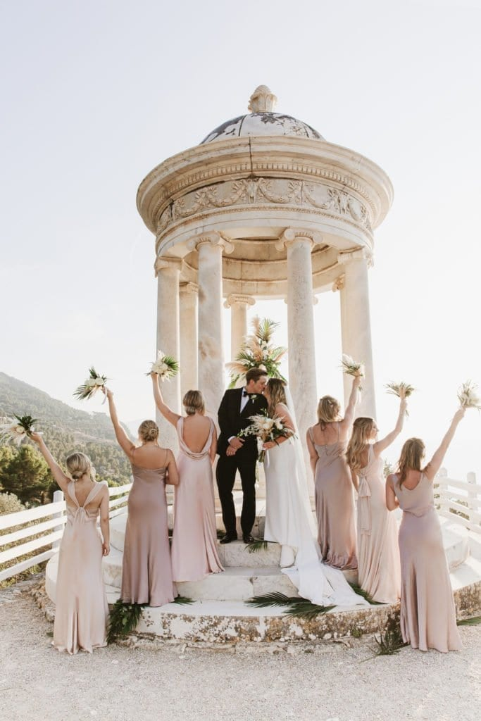 Bridesmaids salute to the newlyweds at Son Marroig in Mallorca