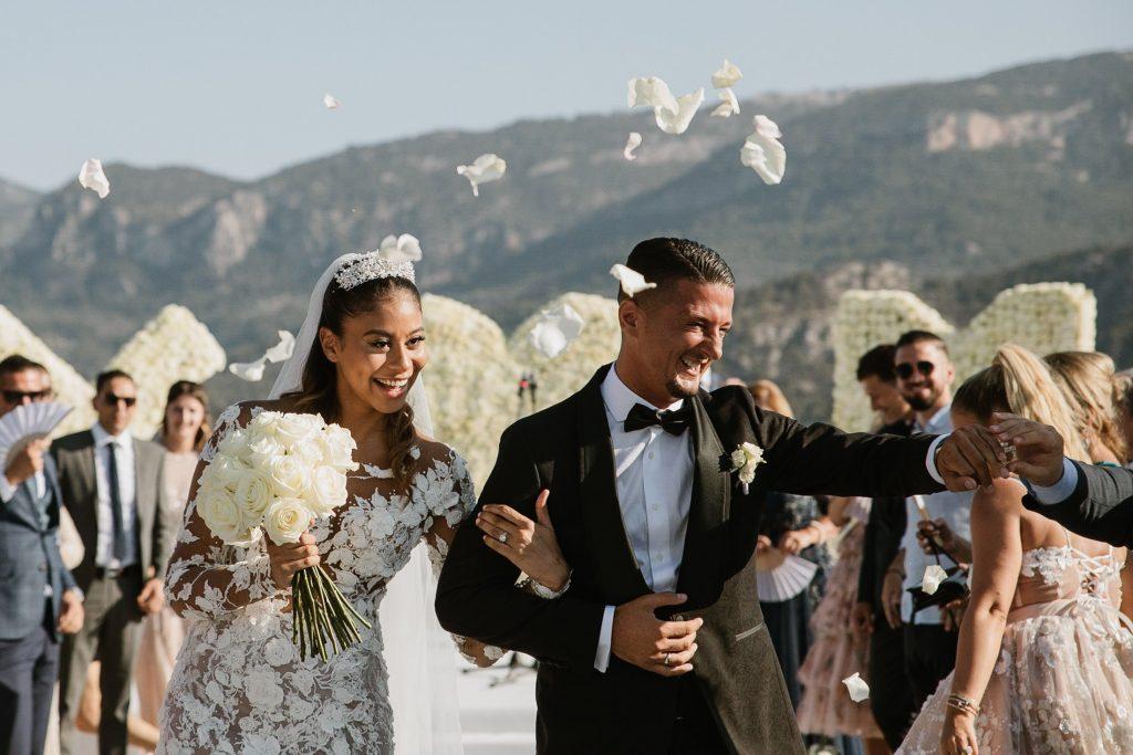 Newlyweds and their confetti aisle walk in Mallorca wedding