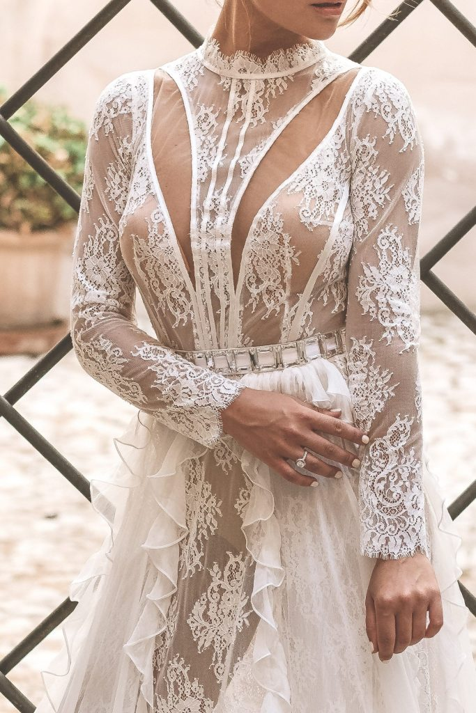 Bride is wearing a contemporary bridal gown by Predrag Djuknik