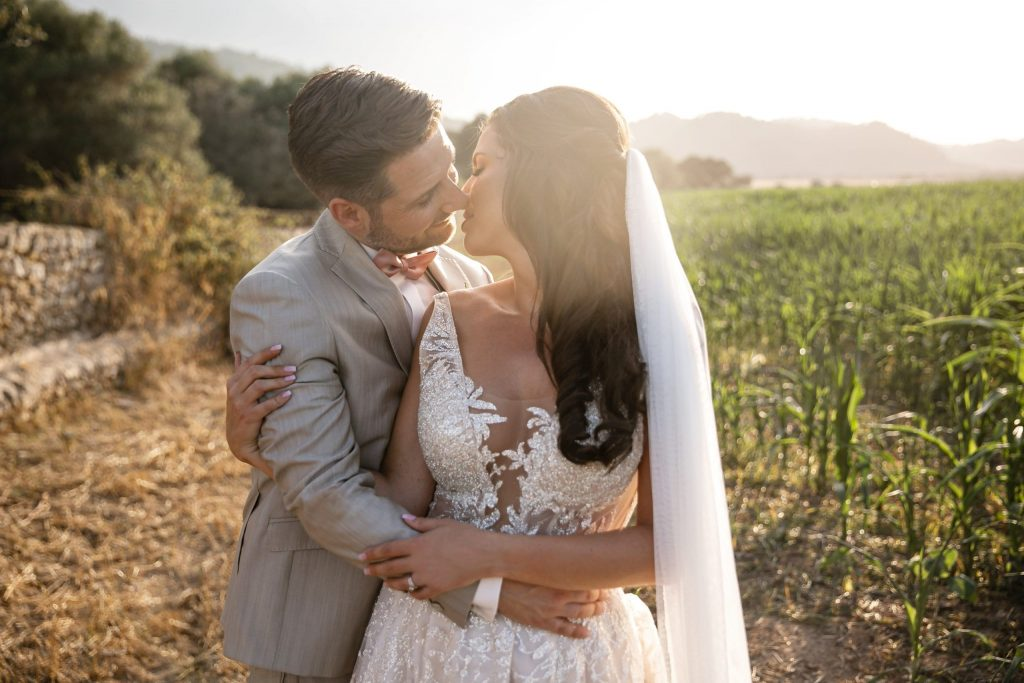 Newlyweds kissing in the countryside after a Mallorca finca wedding at Villa Ribot