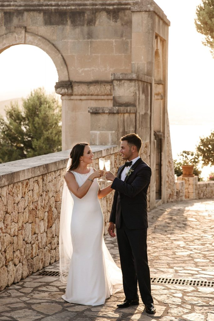 Newlyweds sharing a glass of cava after their ceremony at La Fortaleza