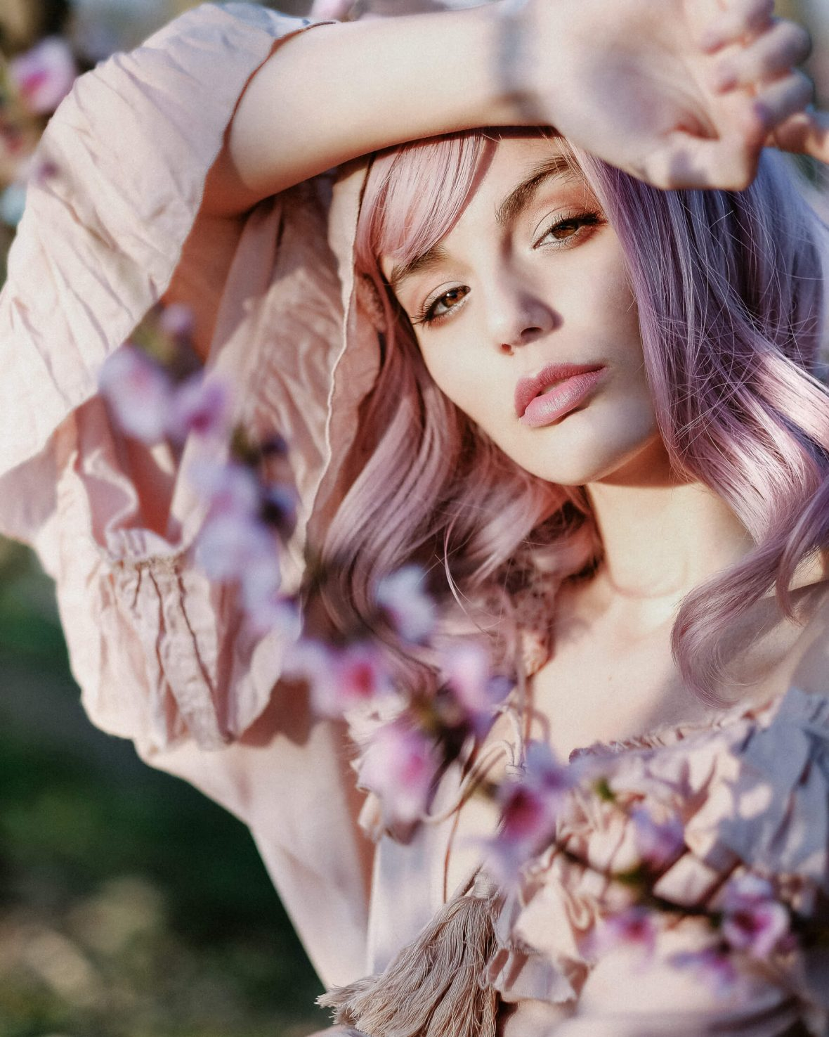 Mallorca fashion shooting wearing all pink in almond blossoms
